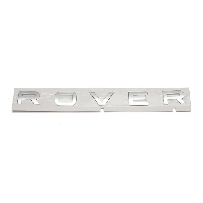 "NAME PLATE FRONT  ""ROVER"" - L320 R/R SPORT TITAN SILVER"