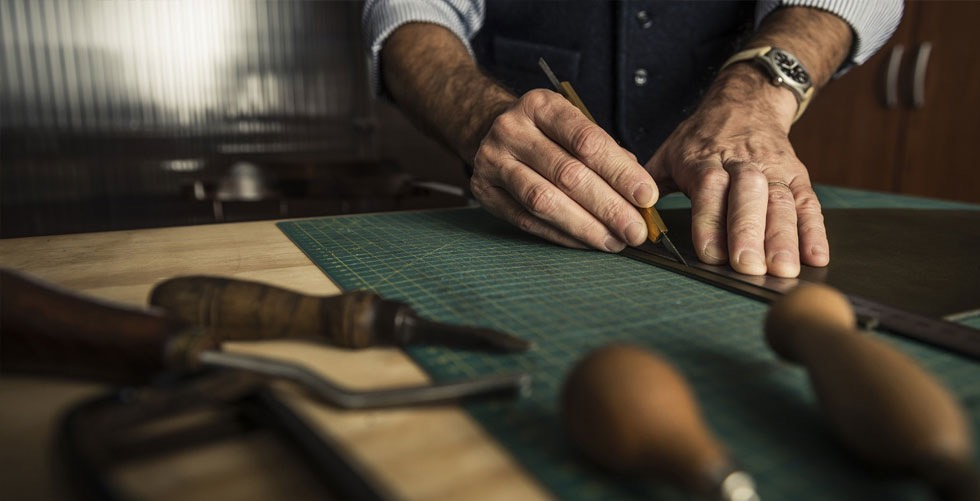 Craftsman working with leather